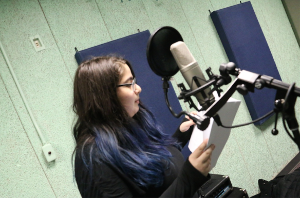 Emma Lasky '16 records an episode for the show. Photo courtesy of The Magical History of Knox County